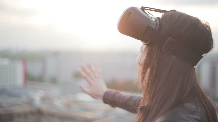 Woman uses a virtual reality glasses on the roof | Shutterstock HD Video #16620757