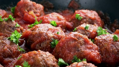 Fresh made Meatballs with tomato sauce (not loopable; 4K)