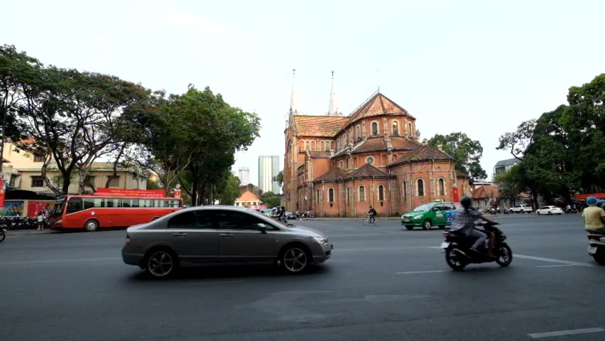 Ho Chi Minh, Vietnam - May 15, 2016: Saigon Notre Dame Cathedral (Vietnamese: Nha Tho Duc Ba) in a daylife, build in 1883 by French colonists. | Shutterstock HD Video #16660537