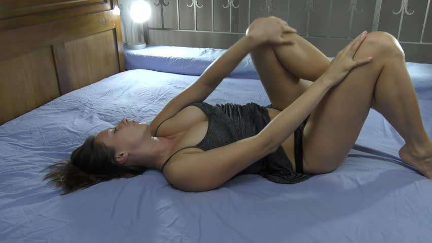 sexy model veronika relaxing in bed and taking off panties