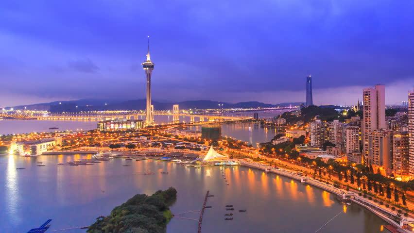 Macau Cityscape Day To Night Time Lapse (pan shot)
