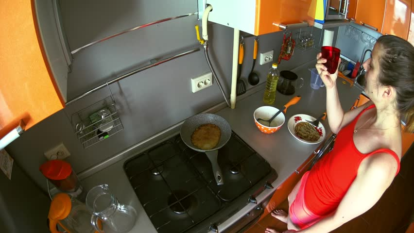 Girl make pancakes on frying pan breakfast in the kitchen put the girl make breakfast pancake in pan and wash the dishes high angle 4k stock ccuart Choice Image