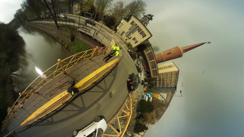People Are Walking by Bridge Through River, Vintage Buildings, Cityscape, vr Video 360, Little Planet Video, Video For Virtual Reality, Time Lapse, Cars Are Driven by a Bridge, Embankment of Smooth