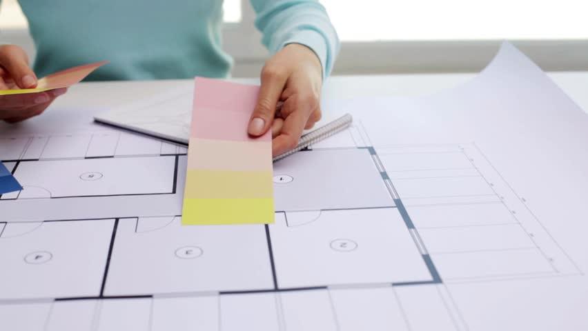 Business architecture design and people concept woman with business architecture design and people concept woman with house blueprint and swatches choosing color stock footage video 16799107 shutterstock malvernweather Image collections