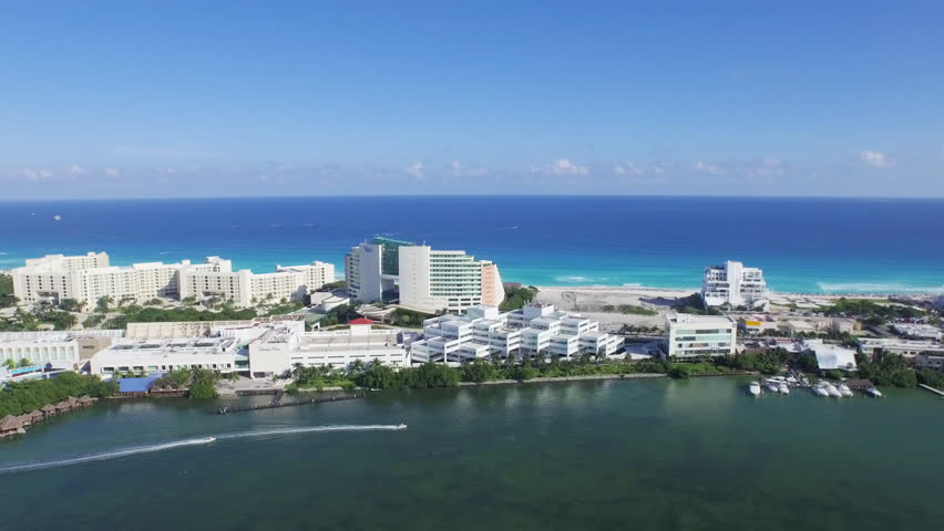 Aerial view of Lagoon and Caribbean Ocean Showing recreation speed boats Cancun Resorts Hotels Shopping Mall and beach