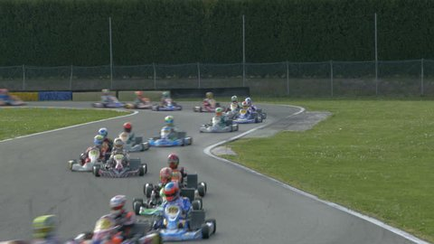 Kart racing or karting. Race karts on the track.  Open-wheel motorsport.