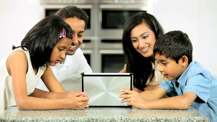 Young Ethnic Family with Wireless Tablet in Kitchen | Shutterstock HD Video #1688497