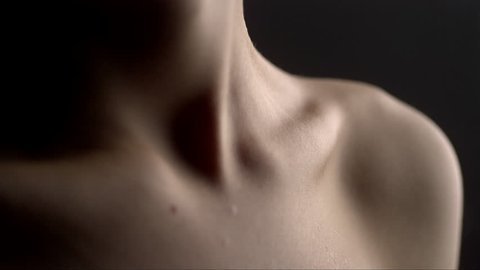 slow motion water drops on a beautiful woman body
