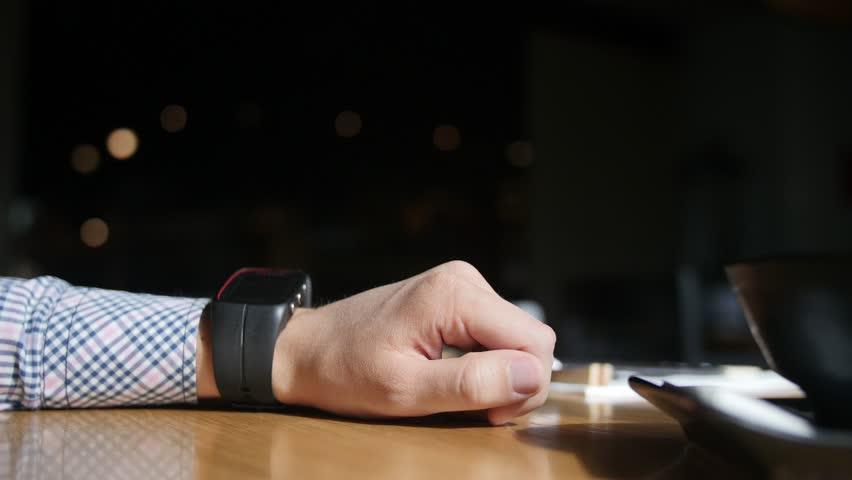 Caucasian man adjusting his smart watch. Close up of hands   Shutterstock HD Video #16893727