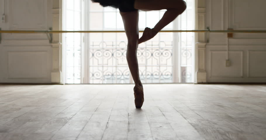 Buenos Aires, Argentina - February 27, 2015: Ballerina performing pirouettes in studio, slow motion #16900717