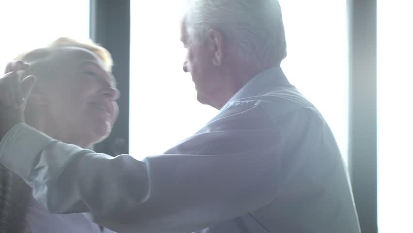 Active retirement and leisure activities, happy dance of an elderly couple