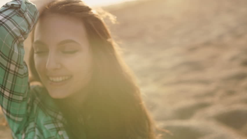 Close up of a smiling relaxed young blond looking away at the beach | Shutterstock HD Video #16939267
