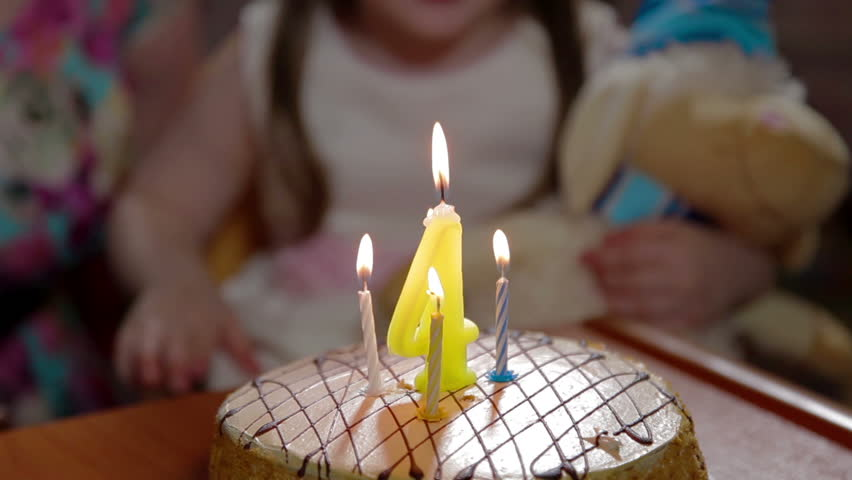 A man lights candles 30 years on a chocolate cake with butterfly girl claps and blows out candles on birthday cake hd stock footage clip sciox Image collections
