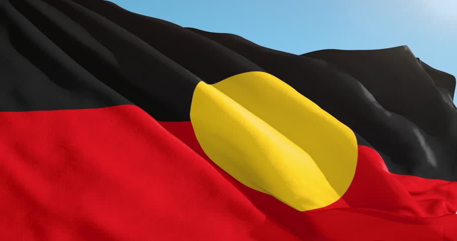 Beautiful slow motion waving Australian Aboriginal Flag. Seamless loop