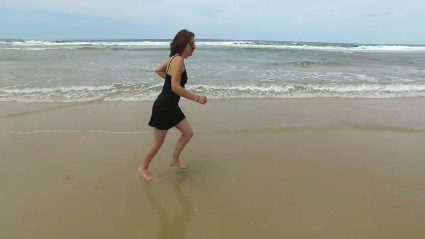 Pretty woman running in the sea | Shutterstock HD Video #17011267