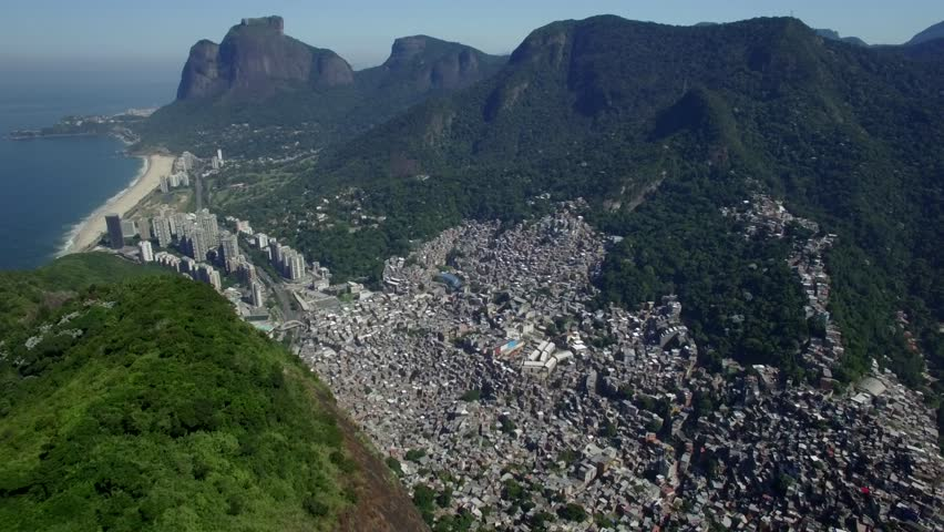 Favela Aerials: High shot above Rocinha favela, Rio de Janeiro, Brazil with wealthy areas in background #17022787