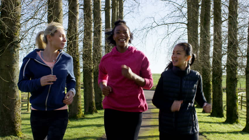 4K Female friends running together outdoors in the countryside. Shot on RED Epic. UK - April, 2016 | Shutterstock HD Video #17024107