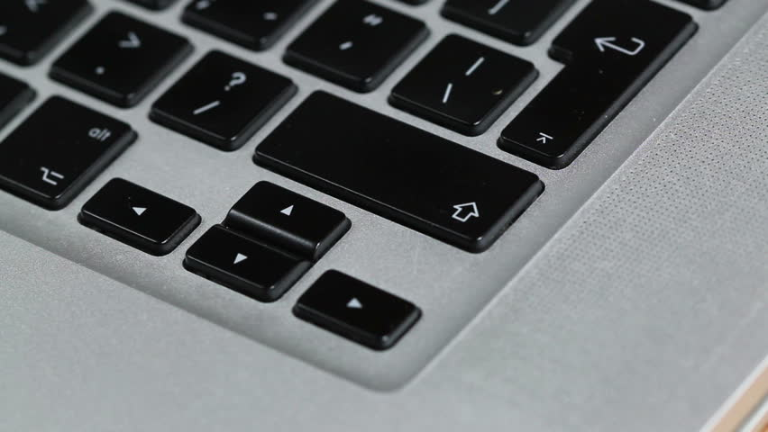 Hand repeatedly pressing the enter key on a macbook laptop keyboard, close up shot, seamless looping, perfect for describing a nervous computer user | Shutterstock HD Video #17025907