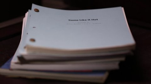 Los Angeles, California - USA - October, 2013: Stack of scripts some like it hot on top rack focus title.