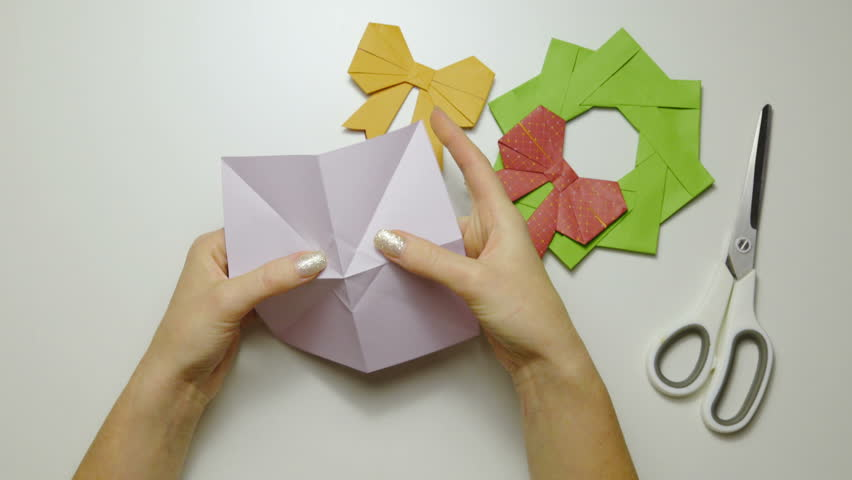 Scissoring Details On Folded Origami Paper 4k Female Person Hands