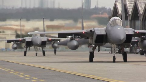 CIRCA 2016 - Numerous F-15 fighter jets line up and taxi for takeoff during a US Air Force Airshow. Filmed using a Sony EX-3 in full HD.