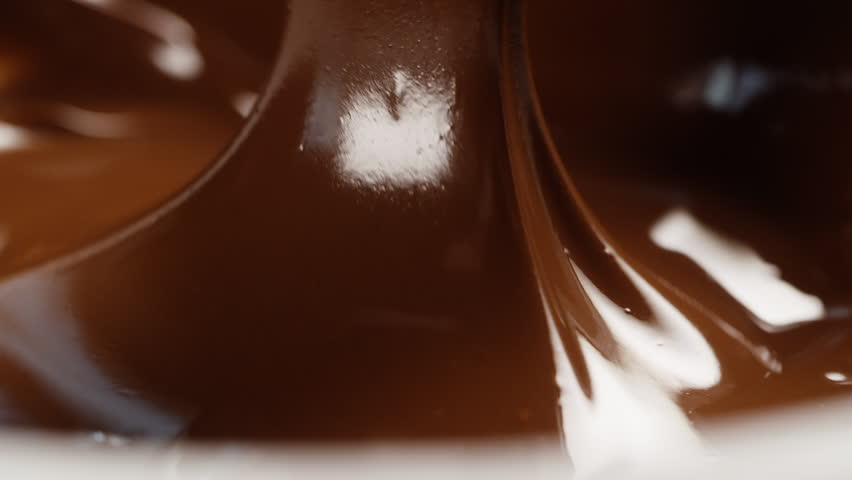 slow motion pouring chocolate background, prores...