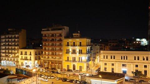 Timelapse video. Bari at night. Traffic near Stazione Centrale (Train Station)