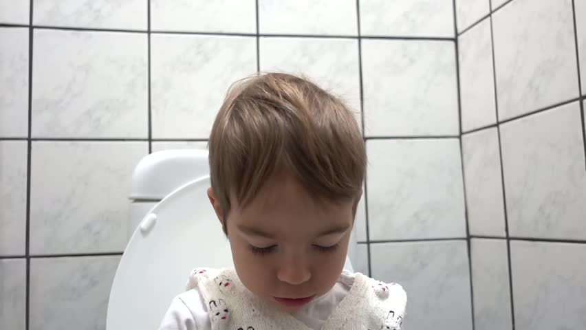 Happy faces of a child in toilet