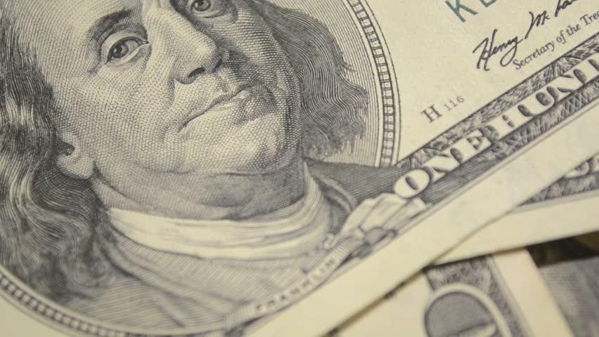Dollars,Money,Close up of US Dollars,Money falling on the paper,100 Dollar