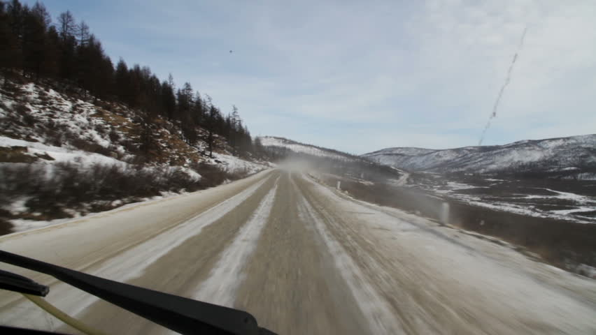 Trucks are traveling on a mountain road. The view from the cab of the truck. Sayan mountains. Siberia. Russian Federation.   Shutterstock HD Video #17123317