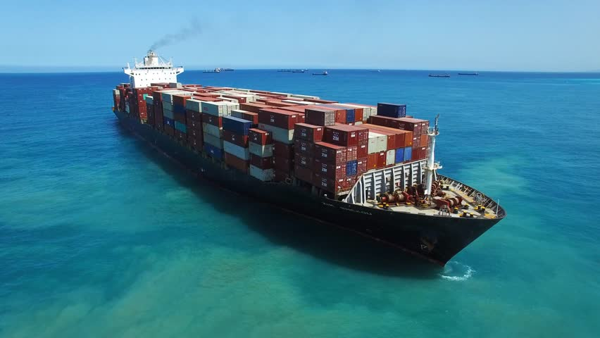 Haifa, Israel, June 7, 2016: Aerial footage of Zim Shekou Container cargo ship at sea, loaded with containers, heading to her next port. | Shutterstock HD Video #17155201