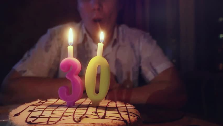 Man With Birthday Cake Blows Candles At His 30th In Slowmotion 1920x1080