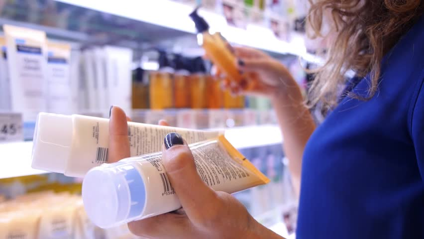 Woman Buying Body Care Products in Supermarket | Shutterstock HD Video #17201827