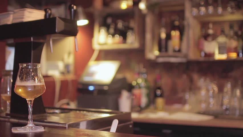 Romantic candlelight dinner at restaurant stock footage video glass of beer at bar counter a half pint of craft beer standing at the mozeypictures Image collections
