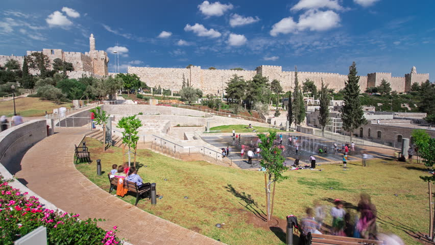 New urban Teddy Park and Tower of David on background under blue sky timelapse hyperlapse in Jerusalem, Israel.