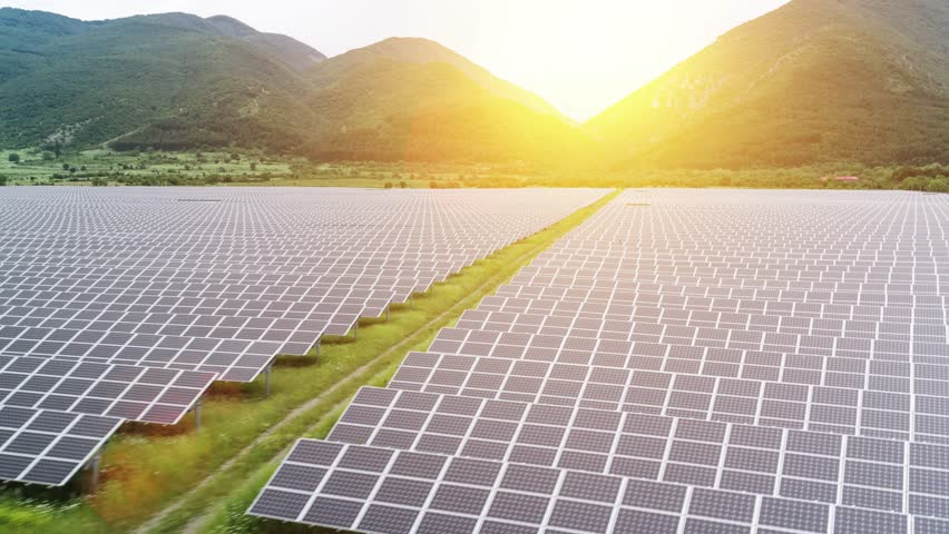 Solar Panels Farm Field Aerial Flight At Sunset Green Energy Conservation Of Power Concept Mountain Landscape | Shutterstock HD Video #17215807