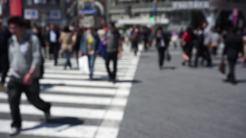 Blurred pedestrians crossing a busy crossing in Tokyo, Japan #17219917