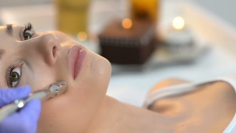 Beautiful woman getting microdermabrasion at beauty salon