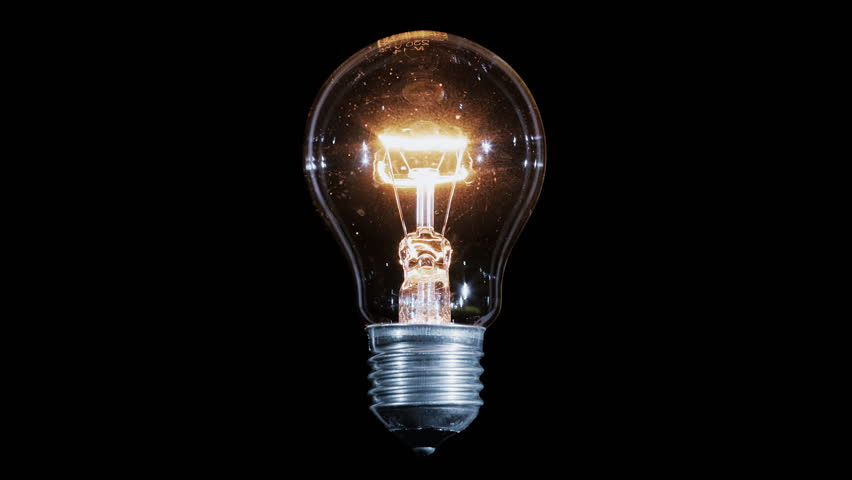 Tungsten light bulb lamp blinking over black background, macro view, loop ready | Shutterstock HD Video #17258128