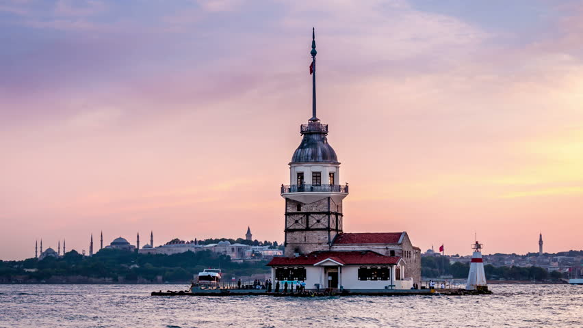 Maiden's tower at the southern entrance of the Bosphorus strait in Istanbul. Day to night transition. Illumination switch on. Easy zoom out