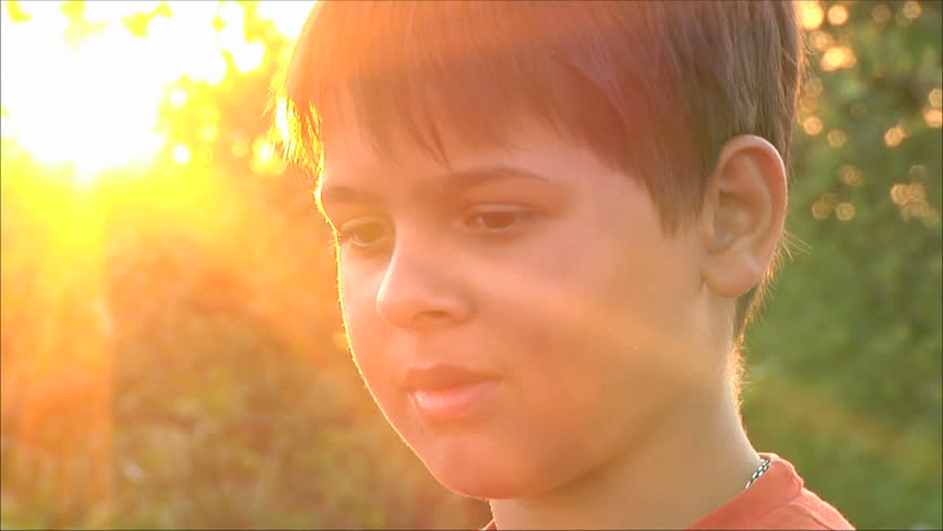 boy at sunset, close-up