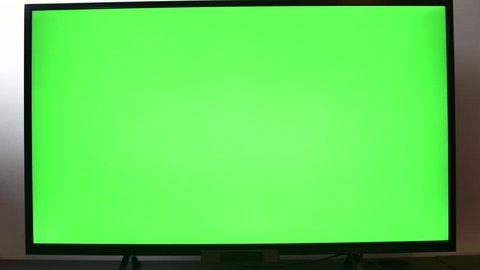 Right Handed Man Adjusting Sound Volume On His TV Set, Hand Detail, Green Screen