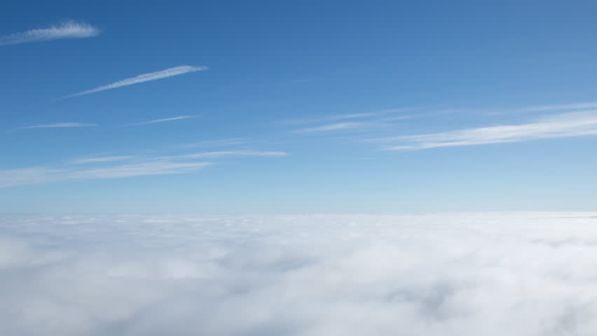 4K time lapse high angle view of approaching wispy clouds and blue sky above the top of an inversion cloud level on a bright sunny day | Shutterstock HD Video #17360077