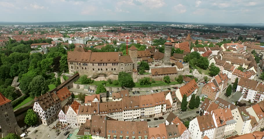 NUREMBERG, GERMANY June 6, 2016: Aerial Shot over Nuremberg. It starts with a shot of the Castle Kaiserburg Nürnberg and then flies out to the old city. The market is seen and the city walls as well.