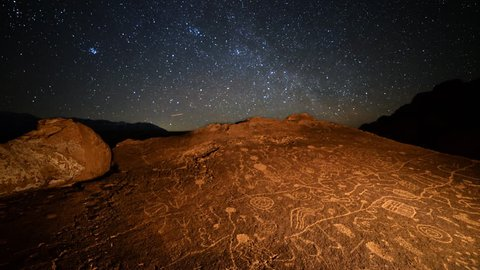 Astrophotography Time Lapse of starry sky over Native American petroglyphs in Eastern Sierra, California -More Rock-