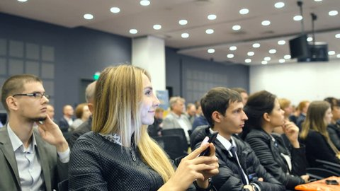 Novosibirsk Russia - June 9 2016: Listening to the speech about marketing and management of the trading company for successful sales. Talk about finance. Economic problems of our time. Closeup indoors