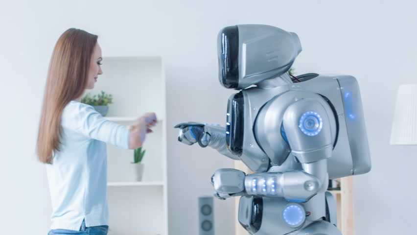 Cheerful woman and robot welcoming each other | Shutterstock HD Video #17433061