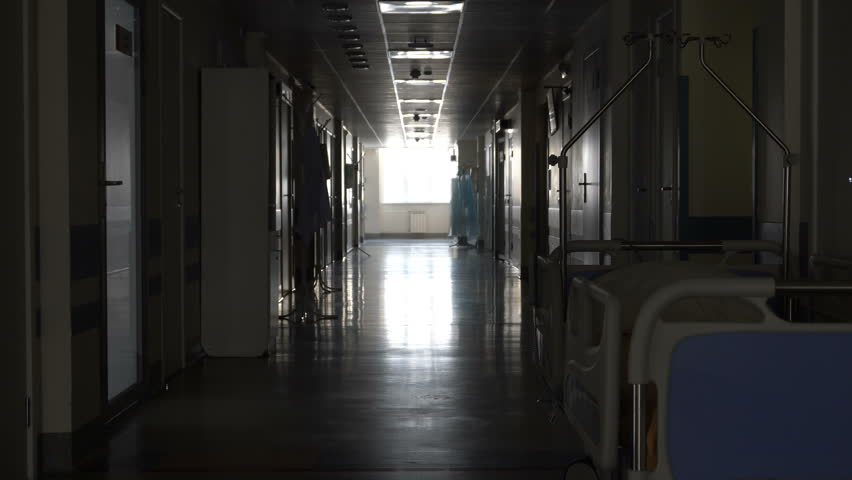 Dark long corridor with a bed in the hospital  | Shutterstock HD Video #17481577