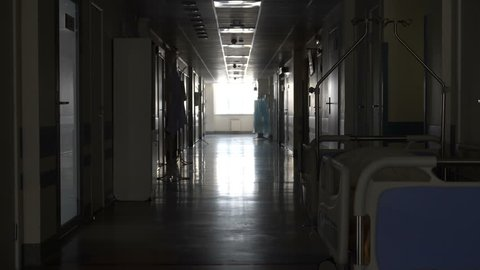 Dark long corridor with a bed in the hospital