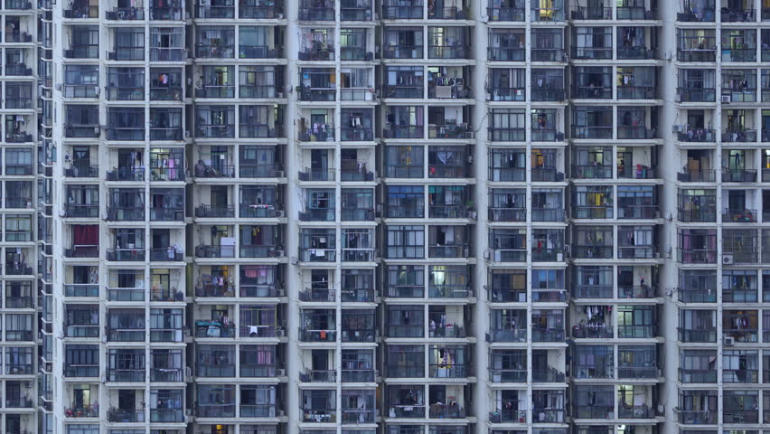 Timelapse of apartment windows at dusk to night....